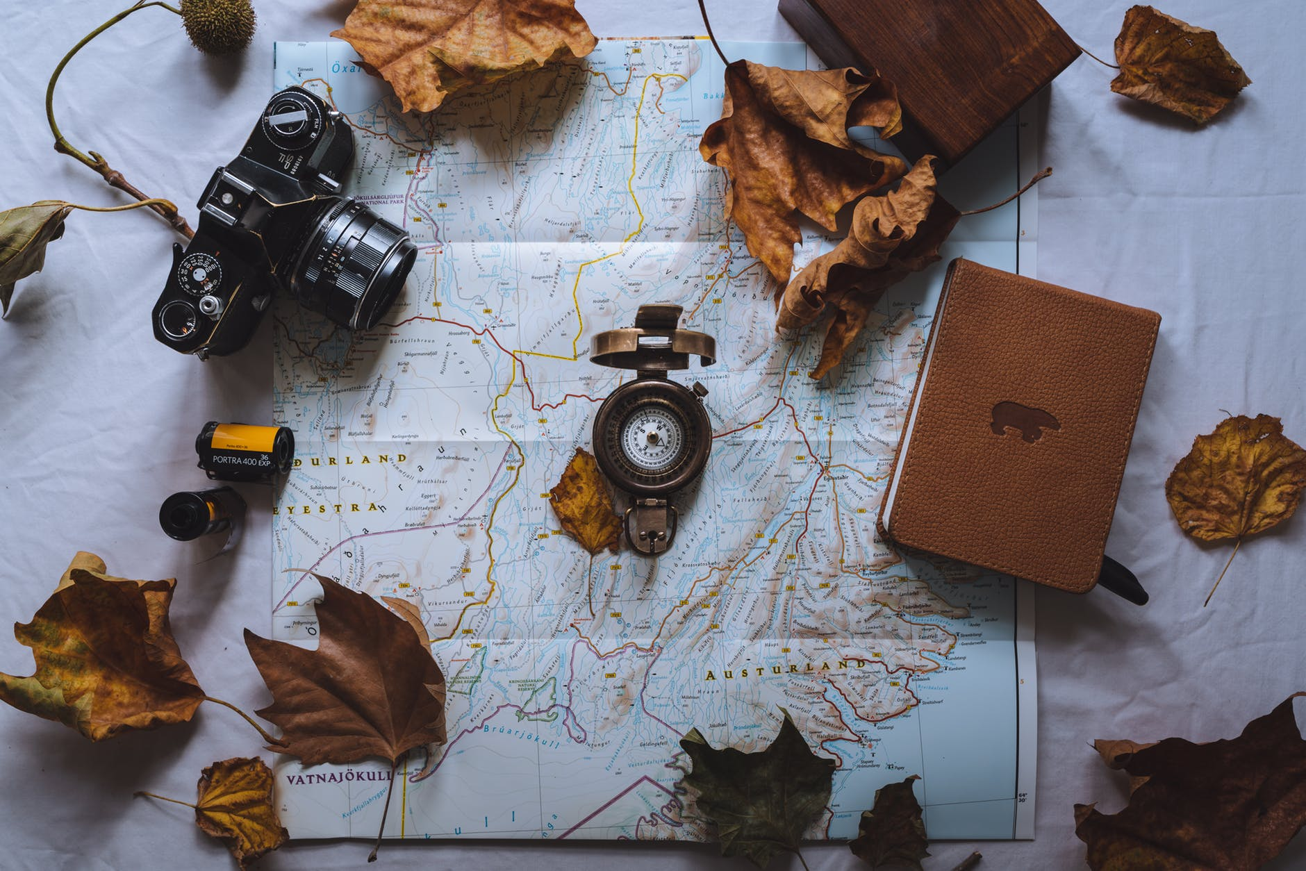 black dslr camera on map